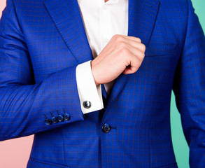 Male fashion. Shirt sleeve with cufflink instead button. Cufflinks match luxury classic suit jacket. Make sure outfit and appearance look perfect. Detail make outfit elegant. Perfect to last detail