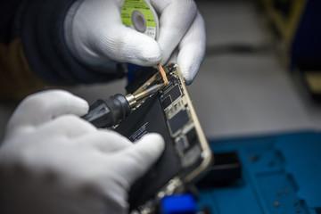 man hands welding, close up, smoke of resin