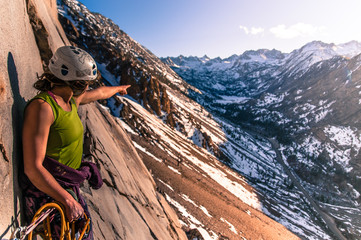 Woman rock climbing, Cardinal Pinnacle, Bishop, California, USA