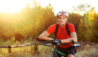 Closeup front view portrait of a cyclist wide picture