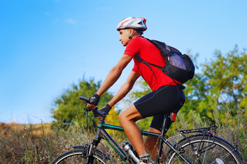 Man having cycling exercises outdoor