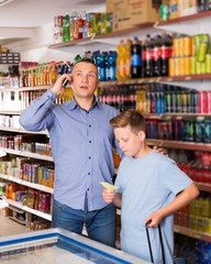 Man talking on phone while visiting supermarket