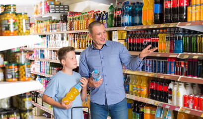 male and  boy  buying sweet beverages