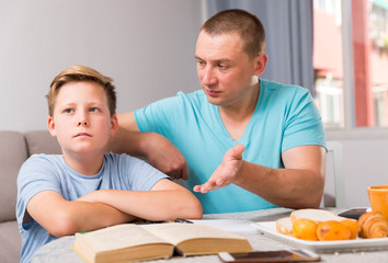 Adult son is not wanting talk with his father in time doing homework