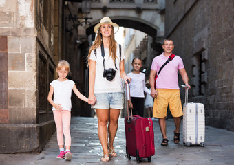 Big family of tourists strolling