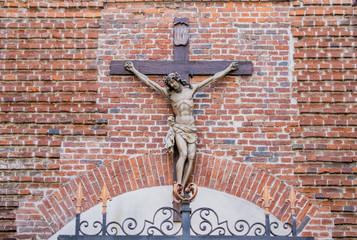 Crucifixion of Jesus on a brick wall background.