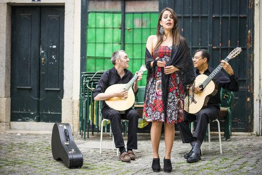 Fado band performing traditional portuguese music in Alfama, Lisbon, Portugal