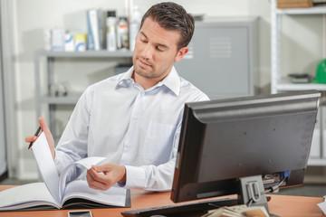 Man reading at his desk