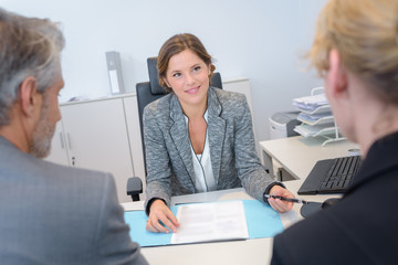 Couple in meeting with businesswoman