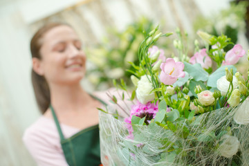 Florist selling a bunch of flowers