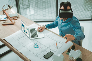 3d glasses. Smart intelligent man using technological developments while working in the office