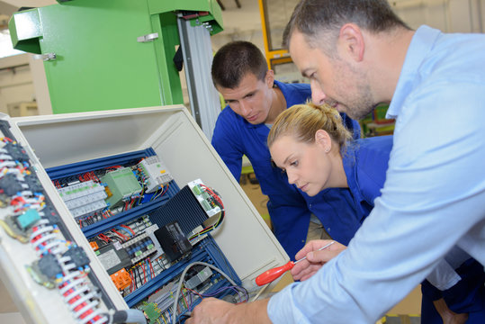 Apprentice electricians being taught