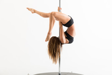 Flexible Dancer Curving Body On Pole While Rehearsing