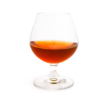 Wineglass with cognac isolated on white background