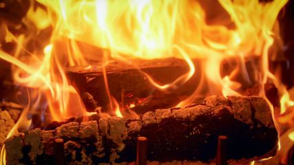Closeup image of firepalce at house with burning logs