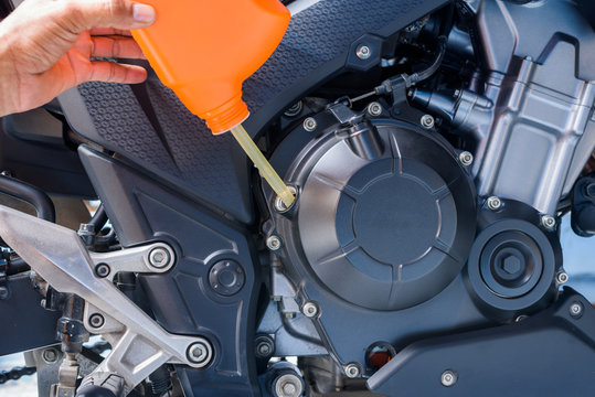 Change the oil,motorcycle engine.