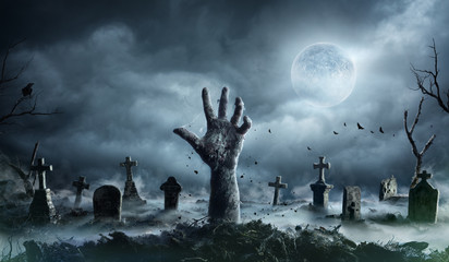 Zombie Hand Rising Out Of A Graveyard In Spooky Night Wall mural