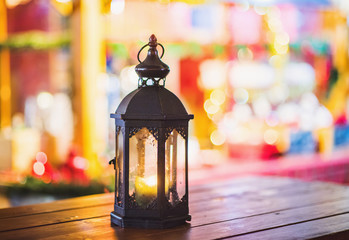 Glass candle lantern on a Christmas market in Germany