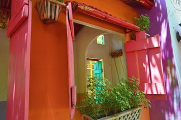 Small colorful house in the garden