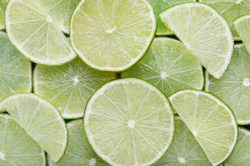 Pieces of lime fruit background