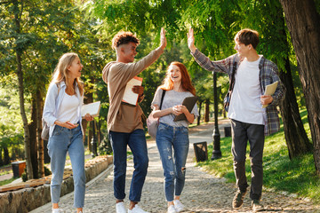 Group of laughing students walking at the campus