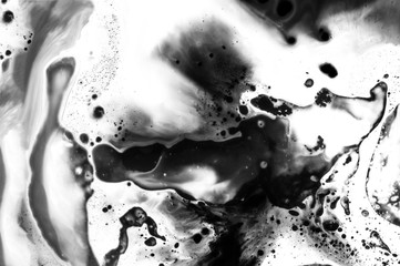 Abstract ink background. Moving liquid paint in water. White abstract shapes in chaotic movement