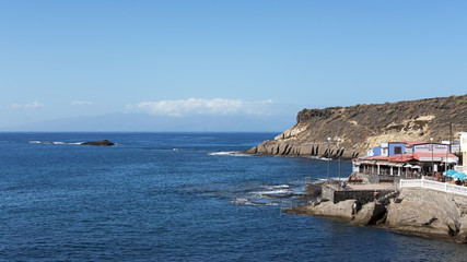 The picturesque village of La Caleta frequented often by tourists for its tranquil coast and for the popular fish restaurants