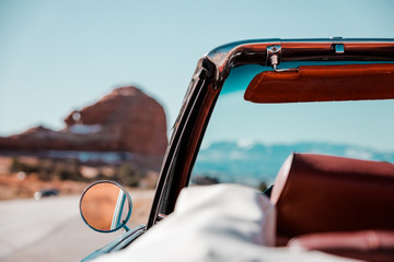 A Road Trip Through The American Southwest In A Classic Convertible Car Wall mural