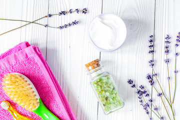 baby accessories with lavender for the bathroom on wooden backgr