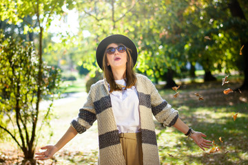 Fashionable woman in the park