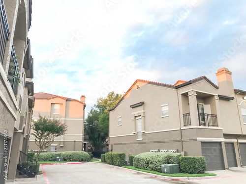 Typical Apartment Complex Condos With Attached Garage And Uncovered Parking Lots At Suburban Area In Irving Texas Usa