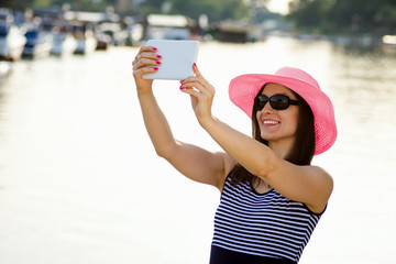 woman tourist with tablet