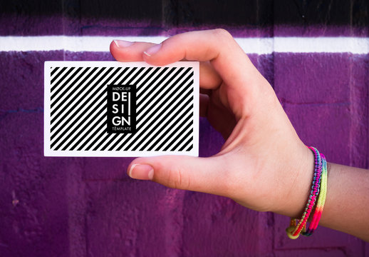 Hand holding Mockup business card over colorful background.