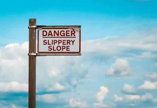 Danger Slippery Slope warning sign on Quayside