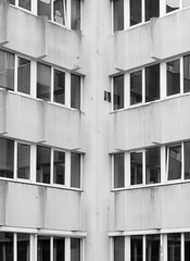 Symmetrical windows creating an interesting background in black and white.