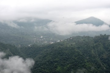 clouds in mountains in landscape