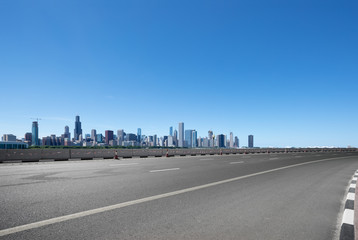 asphalt highway with modern city in chicago