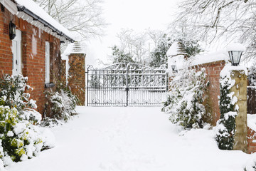 Driveway to rural house in snow