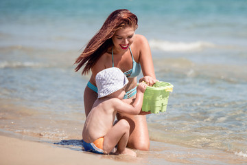 Woman with her son on the beach