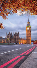 Wall Mural - Buses with autumn leaves against Big Ben in London, England, UK