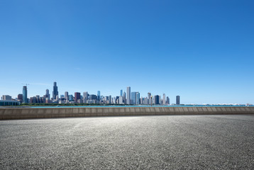 Poster Blauwe jeans asphalt highway with modern city in chicago