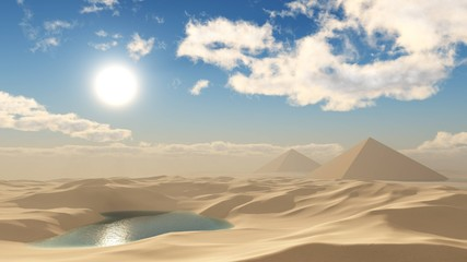 Sandy desert. Pyramids in the desert under the clouds.