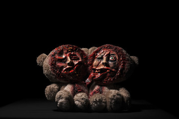 Halloween toy. bears Siamese twins. on a black background