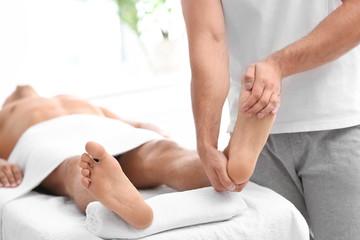 Young woman receiving massage in salon, closeup