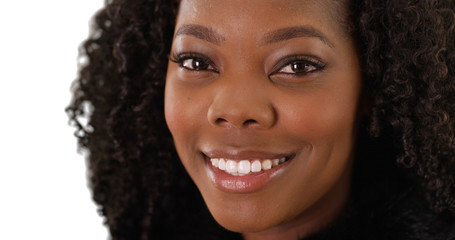 Close up of attractive black woman with radiant smile on white background
