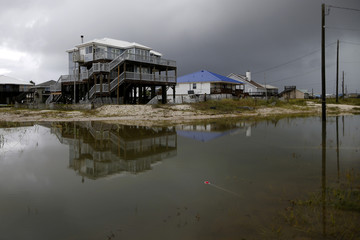 Flood waters from Tropical Storm Gordon are seen in front of a house in Dauphin Island