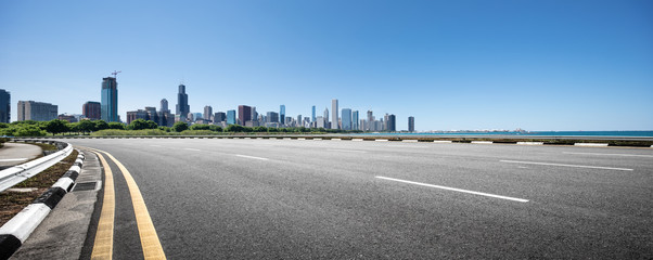 Fototapete - asphalt highway with modern city in chicago