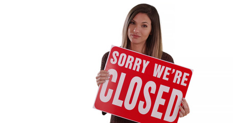 Caucasian Woman holding Closed sign standing on solid white background