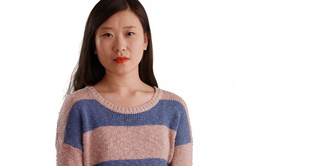 Close-up of confident millennial woman in a sweater on copyspace