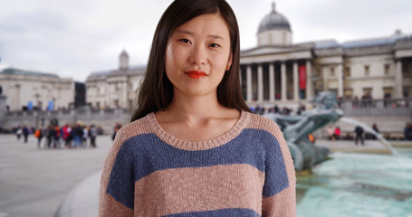 Close up of pleasant millennial woman wearing a sweater in London UK